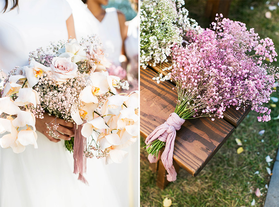 Bridesmaid bouqets of both lilac-colored baby's breath and lush white flowers.