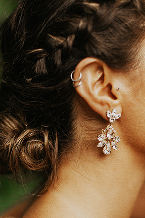 Bride wears earrings from BHLDN's accessories collection.