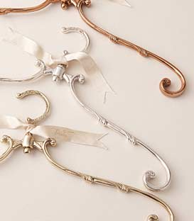 Assorted ornate hangers with delicate bows.