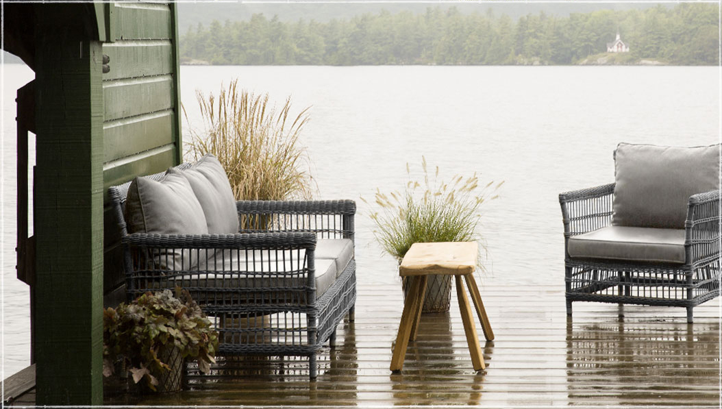 Lounge by the lake | Linger outside with our classic, all-weather wicker. | Shop the Trellis Weave Wicker Collection